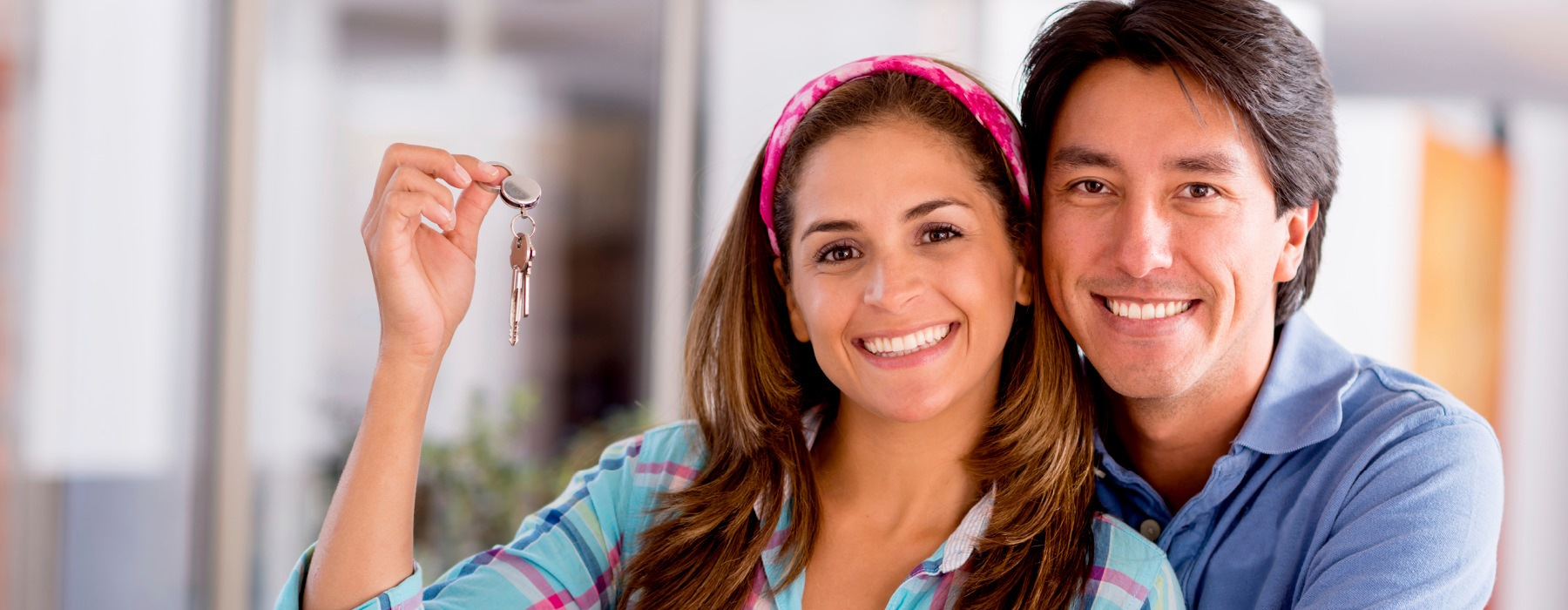 Man and woman holding key.